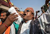A Hindu devotee celebrates after Supreme Court's verdict on a disputed religious site, in Ayodhya, India, November 9, 2019. REUTERS/Danish Siddiqui
