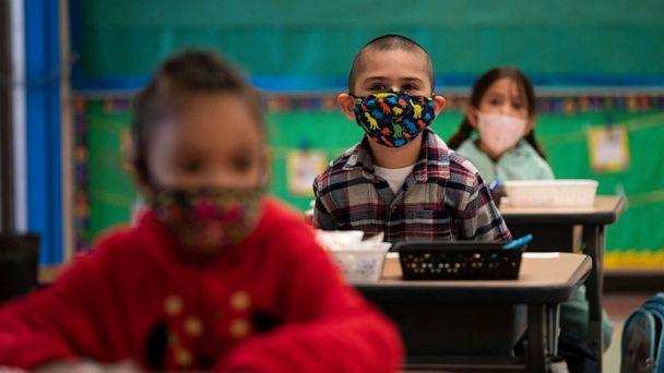 PHOTO: Kindergarten students wearing face masks sit in their classroom on the first day of in-person learning at Maurice Sendak Elementary School in Los Angeles, California, on April 13, 2021, amid the coronavirus pandemic. (Jae C. Hong/AP, File)