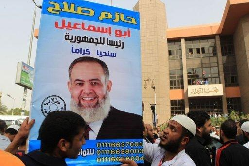 Egyptian Islamists hold up a poster bearing the portrait of Salafist presidential candidate Hazem Abu Ismail