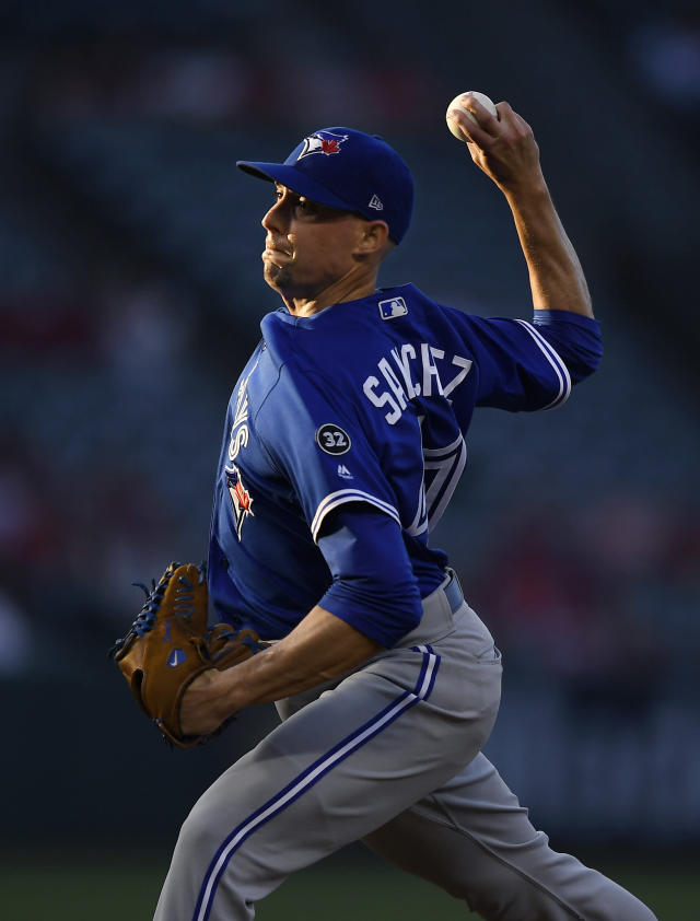 Toronto Blue Jays starting pitcher Aaron Sanchez throws to the plate during the first inning of a baseball game against the Los Angeles Angels on Thursday, June 21, 2018, in Anaheim, Calif. (AP Photo/Mark J. Terrill)