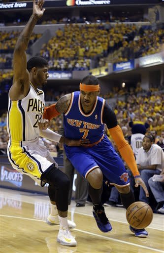 New York Knicks' Carmelo Anthony (7) tries to drive past Indiana Pacers' Paul George (24) during the first half of Game 6 of an Eastern Conference semifinal NBA basketball playoff series Saturday, May 18, 2013, in Indianapolis. (AP Photo/Darron Cummings)