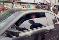<p>Michael Jordan driving a car outside Wrigley Field on opening day, April 4, 1993 in Chicago.</p>