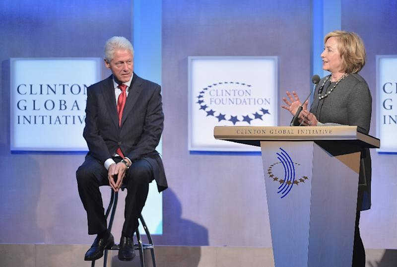 Former US President Bill Clinton and wife, Former US Secretary of State Hillary Clinton address the audience during the Opening Plenary Session: Reimagining Impact for the Clinton Global Initiative on September 22, 2014 in New York City (AFP Photo/Michael Loccisano)