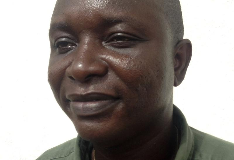 Sheik Umar Khan, head doctor fighting the deadly tropical virus Ebola in Sierra Leone, poses for a picture in Freetown, June 25, 2014. Khan, a Sierra Leonean virologist credited with treating more than 100 Ebola victims, has been transferred to a treatment ward run by medical charity Medecins Sans Frontieres after being infected by the Ebola virus, according to the statement released late on July 22, 2014 by the president's office. REUTERS/Umaru Fofana (SIERRA LEONE - Tags: HEALTH HEADSHOT)