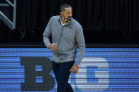 Michigan head coach Juwan Howard cheers on his team as they play against Michigan in the first half of an NCAA college basketball game at the Big Ten Conference tournament in Indianapolis, Saturday, March 13, 2021. (AP Photo/Michael Conroy)