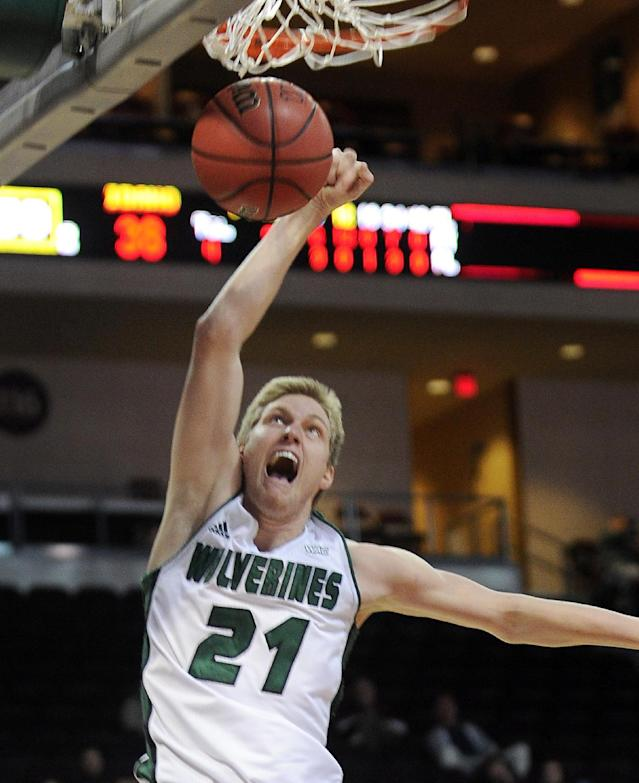 Utah Valley's Zach Nelson dunks the ball during the second half of an NCAA college men's basketball game against Idaho in the semifinals of the West Athletic Conference tournament Friday, March 14, 2014, in Las Vegas. Idaho won 74-69. (AP Photo/David Becker)