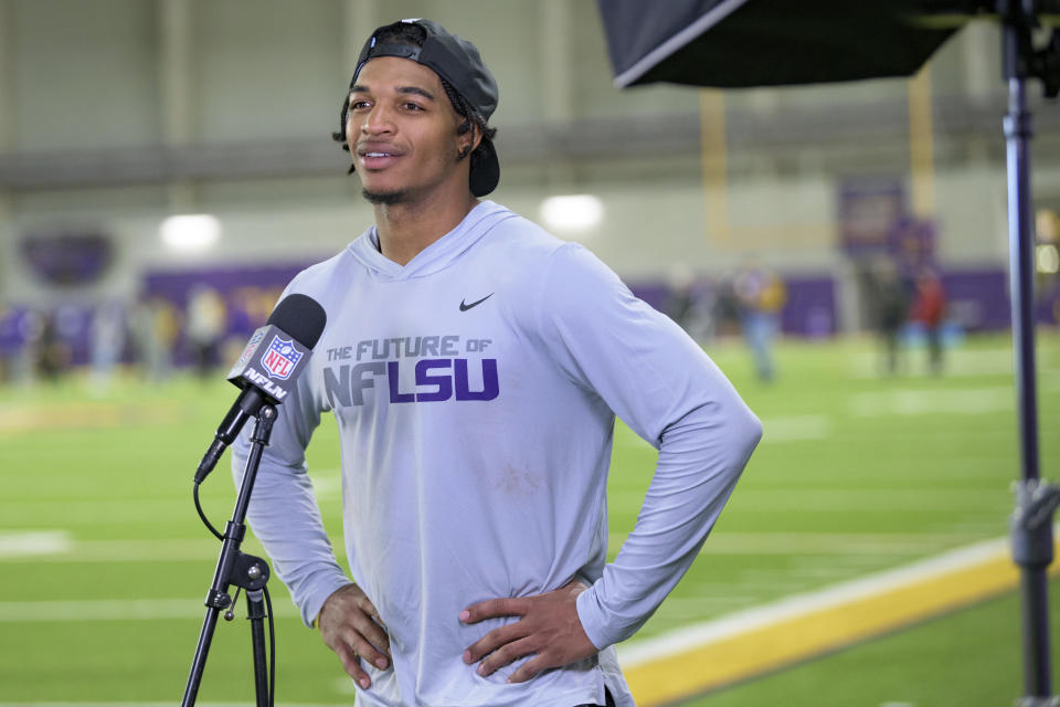 FILE - LSU wide receiver Ja'Marr Chase is interviewed by the NFL Network during an NFL Pro Day at LSU in Baton Rouge, La., in this Wednesday, March 31, 2021, file photo. Chase is expected to be a first round pick in the NFL Draft, April 29-May 1, 2021, in Cleveland. (AP Photo/Matthew Hinton, File)