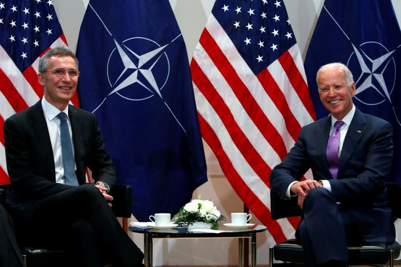 FILE PHOTO: Then-U.S. Vice President Joe Biden (R) meets NATO Secretary General Jens Stoltenberg at the annual Munich Security Conference in Munich, Germany