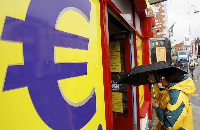 A woman enters a euro discount store in south Dublin, Ireland, Monday, Nov. 22, 2010. Ireland's banks will be pruned down, merged or sold as part of a massive EU-IMF bailout, the government says as a shellshocked nation comes to grips with its failure to protect its financial institutions.   (AP Photo/Peter Morrison)