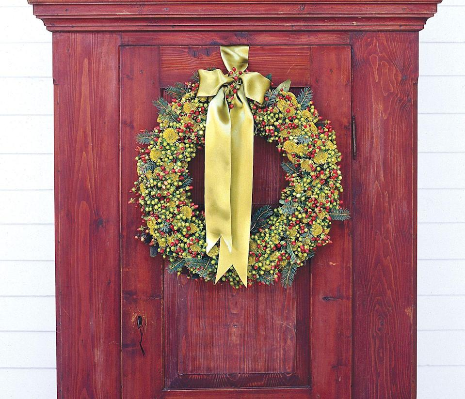 "<p>Soak an oasis wreath form, then push in stems of balsam, chrysanthemum, and hypericum berries. Lime-colored flowers give a wreath a mossy appeal.</p><p><a class=""link rapid-noclick-resp"" href=""https://www.amazon.com/Richland-Oasis-Wreath-Base-15/dp/B075MRCPC8?tag=syn-yahoo-20&ascsubtag=%5Bartid%7C10055.g.2361%5Bsrc%7Cyahoo-us"" rel=""nofollow noopener"" target=""_blank"" data-ylk=""slk:SHOP WREATH FORMS"">SHOP WREATH FORMS</a></p>"