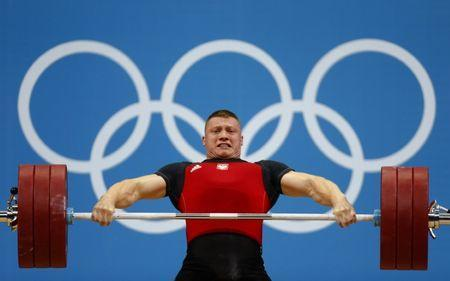 Poland's Tomasz Bernard Zielinski lifts on the men's 94Kg group B weightlifting competition at the ExCel venue at the London 2012 Olympic Games August 4, 2012. REUTERS/Dominic Ebenbichler