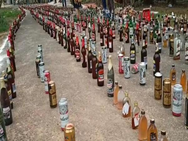 Illegal liquor bottles seized by Andhra Police. (Photo/ANI)