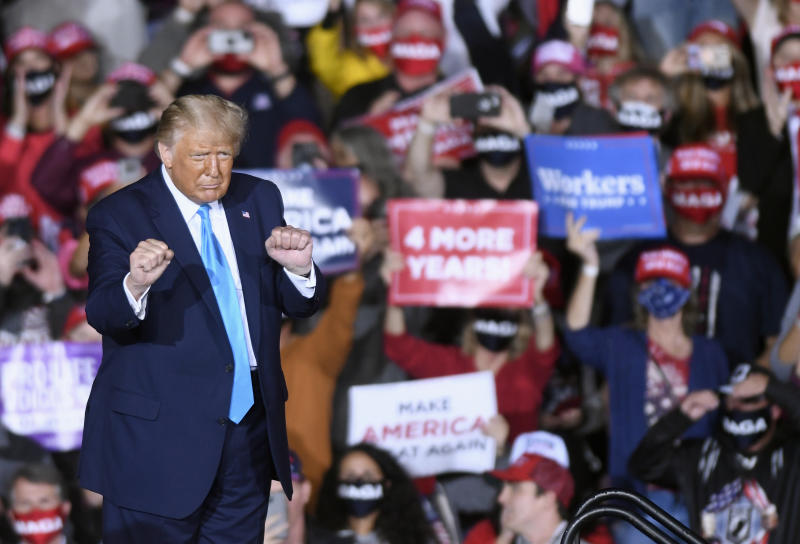 President Donald Trump dances during a campaign rally at Harrisburg International Airport in Pennsylvania.