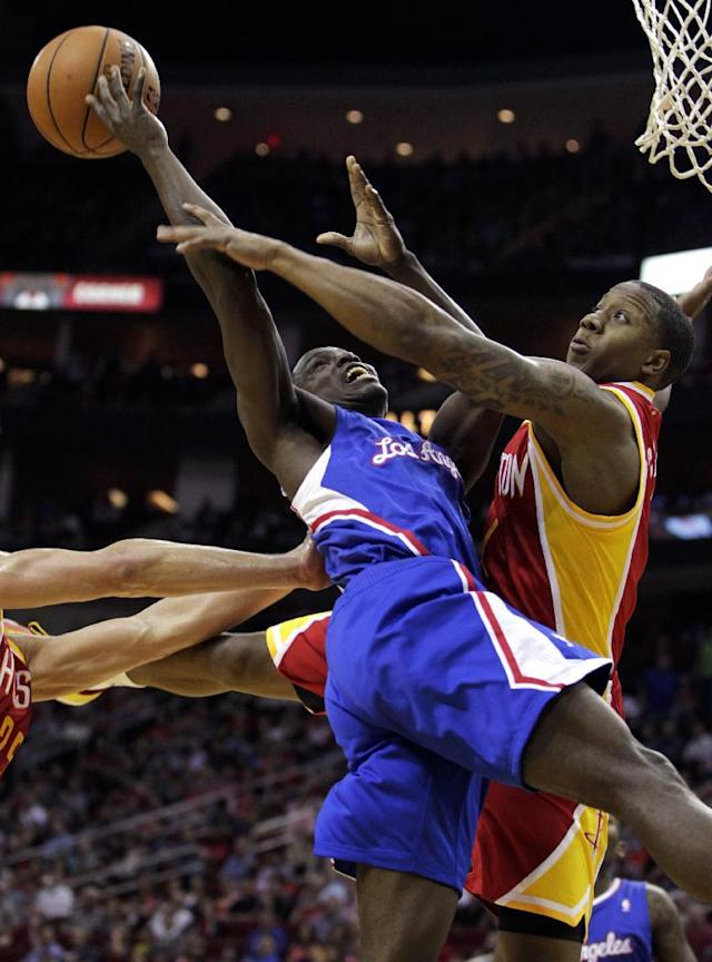 Los Angeles Clippers guard Darren Collison is fouled by Houston Rockets guard Isaiah Canaan during the first quarter of an NBA basketball game, Saturday, March 29, 2013, in Houston. (AP Photo/Patric Schneider)
