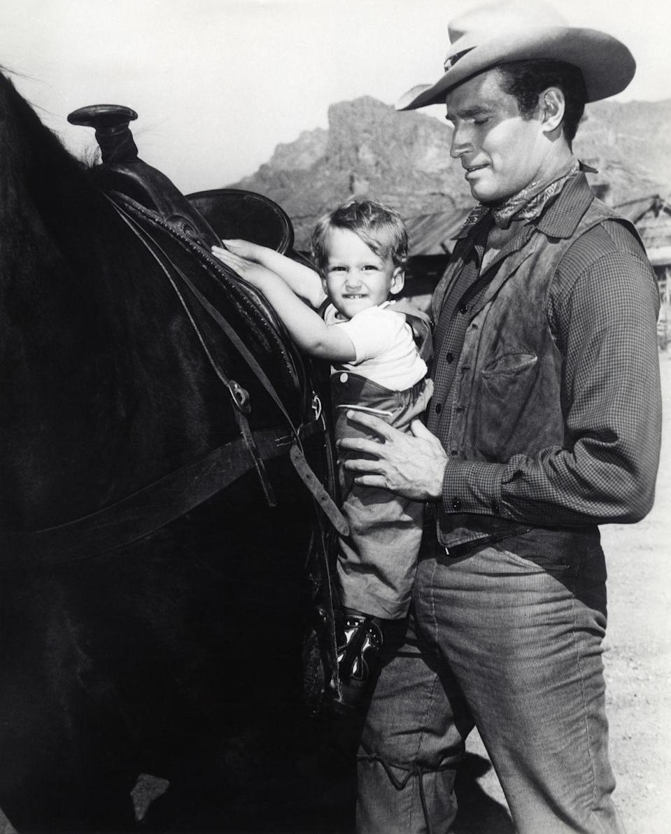 <p>When he was a little over one, Fraser Heston visited his father, Charlton Heston, on the set of one of his Western films, <em>Three Violent People</em>. What he got out of it is not your average pony ride.</p>