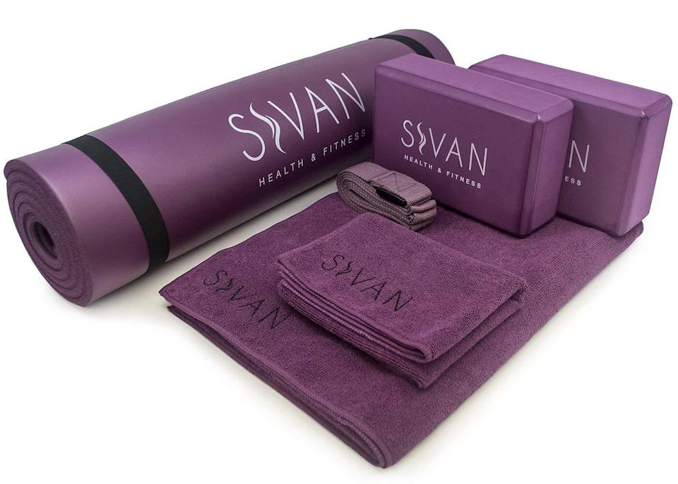 """<p>With over 1,300 reviews and an average of 4.5 stars on Amazon, this set has all you need to begin your yoga journey for the year. Reviewers praise the half-inch memory foam mat for making their yoga sessions much more comfortable and easy on knees.<br><strong><a rel=""""nofollow noopener"""" href=""""https://fave.co/2Awwyuu"""" target=""""_blank"""" data-ylk=""""slk:Shop It"""" class=""""link rapid-noclick-resp"""">Shop It</a>:</strong> $42, <a rel=""""nofollow noopener"""" href=""""https://fave.co/2Awwyuu"""" target=""""_blank"""" data-ylk=""""slk:amazon.com"""" class=""""link rapid-noclick-resp"""">amazon.com</a> </p>"""