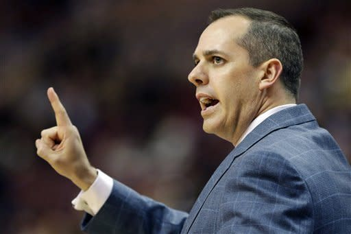 Indiana Pacers head coach Frank Vogel directs his team during the first half of an NBA basketball game against the Philadelphia 76ers, Wednesday, Feb. 6, 2013, in Philadelphia. (AP Photo/Matt Slocum)