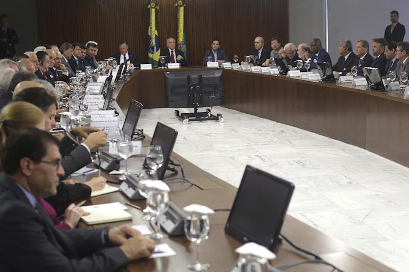 Brazil's President Michel Temer, center top, leads a meeting with agriculture and meat sector representatives at Planalto presidential palace in Brasilia, Brazil, Sunday, March 19, 2017. Temer is holding several meetings on Sunday in light of a recent corruption probe that revealed Brazilian meatpackers bribed inspectors to keep rotten meat on the market. (AP Photo/Eraldo Peres)