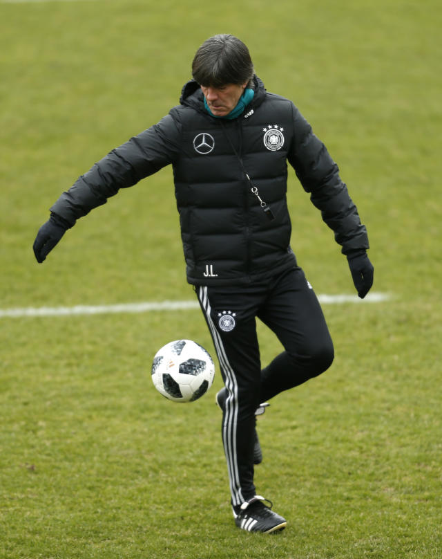 Germany's national soccer coach, Joachim Loew kicks the ball during a training session in Duesseldorf, Germany, Wednesday, March 21, 2018. Germany will face Spain in an International friendly soccer match on Friday. (Federico Gambarini/dpa via AP)