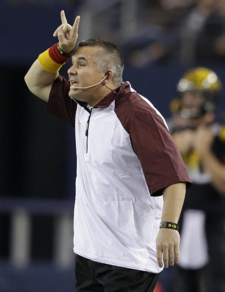 Arizona State coach Todd Graham signals from the sidelines during the first half of an NCAA college football game against Notre Dame on Saturday, Oct. 5, 2013, in Arlington, Texas. (AP Photo/LM Otero)