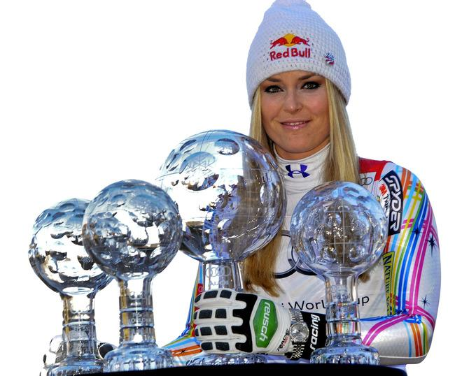 "This handout picture released on March 18, 2012 by the Austrian Ski Federation shows Overall World Cup winner Lindsey Vonn from the US posing with her World Cup crystal globe trophies at the FIS Alpine Skiing World Cup in Schladming.  AFP PHOTO / AUSTRIAN SKI FEDERATION / ERICH SPIESS   RESTRICTED TO EDITORIAL USE - MANDATORY CREDIT ""AFP PHOTO /  AUSTRIAN SKI FEDERATION / ERICH SPIESS /"" - NO MARKETING NO ADVERTISING CAMPAIGNS - DISTRIBUTED AS A SERVICE TO CLIENTS---"