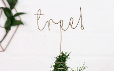 The Letter Loft Slogan Tree Topper - Credit: Not On The High Street