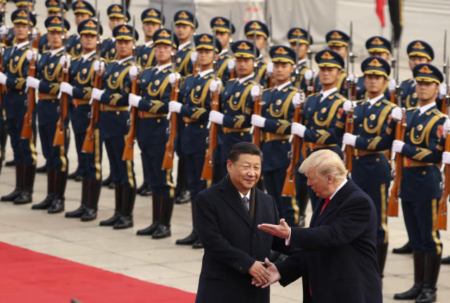 FILE – In this Nov. 9, 2017, file photo, President Donald Trump and Chinese President Xi Jinping participate in a welcome ceremony at the Great Hall of the People in Beijing, China. (AP Photo/Andrew Harnik, File)