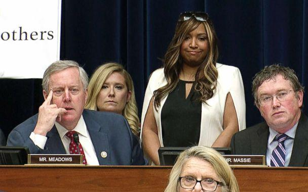 PHOTO: In this image made from a Feb. 27, 2019, video, Lynne Patton who works in the Trump administration at the Department of Housing and Urban Development, stands behind Rep. Mark Meadows as Michael Cohen testifies on Capitol Hill in Washington, D.C. (AP)