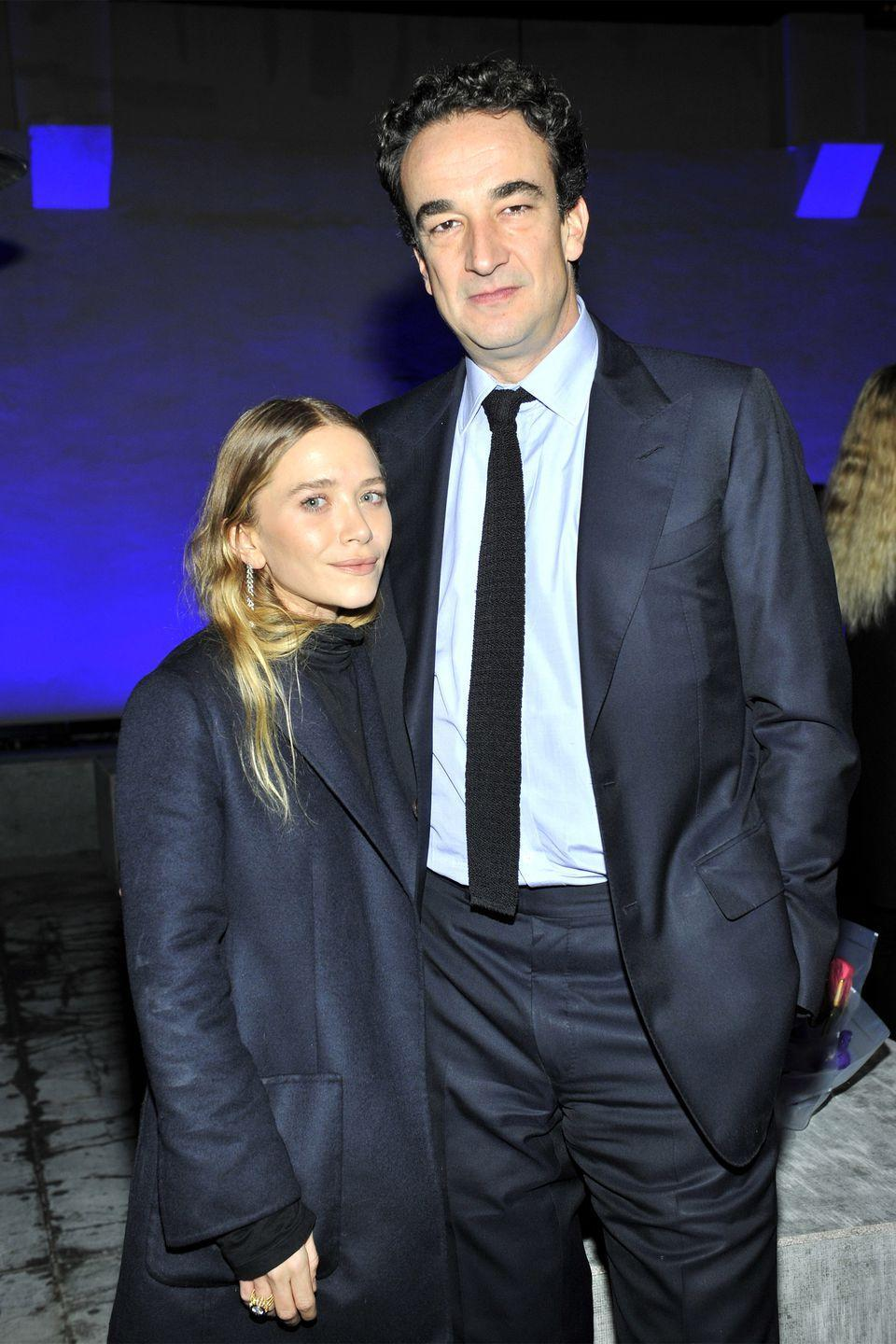 "<p>French banker Olivier Sarkozy, 50, and Mary-Kate Olsen, 33, got engaged in 2014 after reportedly dating for two years. The couple married in a small ceremony in 2015, where <a href=""https://pagesix.com/2015/11/29/mary-kate-olsen-and-olivier-sarkozy-tie-the-knot/"" rel=""nofollow noopener"" target=""_blank"" data-ylk=""slk:party decor included"" class=""link rapid-noclick-resp"">party decor included</a> ""bowls and bowls filled with cigarettes."" The two <a href=""https://www.usmagazine.com/celebrity-news/news/mary-kate-olsen-opens-up-about-married-life-with-olivier-sarkozy-w471229/"" rel=""nofollow noopener"" target=""_blank"" data-ylk=""slk:currently reside"" class=""link rapid-noclick-resp"">currently reside</a> in a $6.25 million townhouse in New York City.</p>"