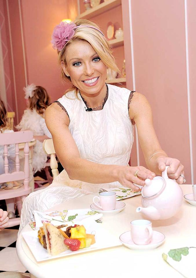 "Anyone for tea? Kelly Ripa was all smiles at her Tea Party for a Cause fundraiser at The Plaza Hotel in NYC Thursday. The Electrolux-sponsored benefit was held to support the Ovarian Cancer Research Fund. Electrolux will donate $750,000 to the fund, and in addition, will donate $1 for every person who joins Kelly's virtual tea party at <a href=""http://www.kelly-confidential.com/"" target=""new"">Kelly-confidential.com</a>. Dimitrios Kambouris/<a href=""http://www.gettyimages.com/"" target=""new"">GettyImages.com</a> - March 10, 2011"
