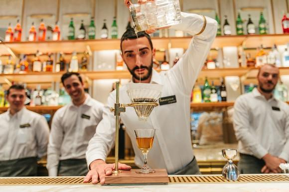 A bartender prepares a cocktail at the Roastery bar.