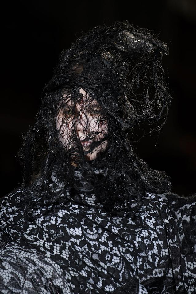 "Oh the webs Comme weaves! The show, called ""Ceremony of Separation,"" brought grief and torturous pain to life with black headpieces seemingly made out of spider webs that completely obscured one's view of the model's face."