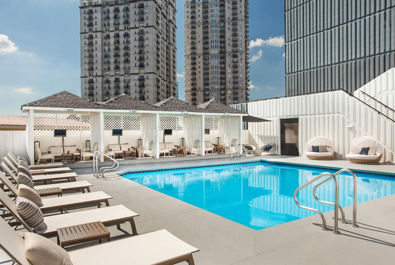 """<p><strong>Set the scene.</strong><br> You may walk in on any manner of party in the hotel's lobby, which it calls its living room—live music performance, drag queen bingo, DJs spinning—welcome to the W Atlanta - Midtown.</p> <p><strong>Gotcha. So who are our fellow guests?</strong><br> Late-to-bed, late-to-rise travelers who never tire of a good DJ set.</p> <p><strong>What's the deal with the rooms?</strong><br> Neutral-toned with pops of purple, the décor (leather headboards, psychedelic wallpaper) matches the excitement of the Midtown skyline just outside your window. I decided to stay in the """"Fabulous Room"""" because it's on an upper floor; stay too close to the first-floor lobby, and it's tough to block out the noise. There were a few upkeep issues—a rip in the headboard, a little mold in the bathroom—but nothing worth making a big deal over.</p> <p><strong>Anything else we should know?</strong><br> Unless you're a Starwood Preferred Guest, wireless high-speed Internet access is $14.95 a day in guest rooms. Boo.</p> <p><strong>How's the service at the front desk?</strong><br> Want to sample more Midtown nightlife? The front desk offers a full list of nearby clubs and bars, plus phone numbers for late-night pizza delivery.</p> <p><strong>Are there any amenities that wowed you?</strong><br> Planning a day by the pool? Reserve one of the four cabanas, each with its own personalized sound system.</p> <p>TRACE, the hotel's Southern-inspired restaurant, is only open for breakfast. Though it claims to """"trace"""" its ingredients back to local purveyors, only a handful of menu items make that connection clear.</p> <p>The onsite Bliss Spa has a nail lounge, steam showers, and saunas. After your """"blissage,"""" keep the decadence going with a chocolate brownie from the brownie buffet.</p> <p>Drivers, be warned: It's $40 per night to valet your car, and there's no self-parking option.</p> <p><strong>Who should be booking a stay here?</strong><br> If you like a good party and don't """