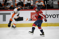 Washington Capitals center Garrett Pilon (40) and Philadelphia Flyers left wing Samuel Morin (55) lose their balance after colliding during the first period of an NHL hockey game Saturday, May 8, 2021, in Washington. (AP Photo/Nick Wass)
