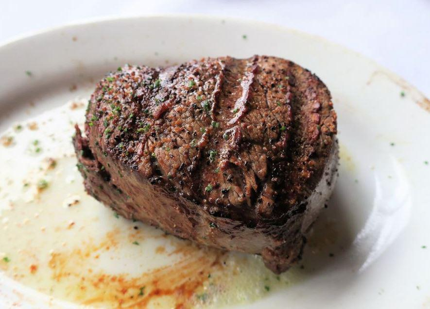 <p>You know that sizzling effect that Ruth's Chris is famous for? That's the result of adding a big dollop of butter to the pan right before the steak is served. Steakhouses use all sorts of techniques to make sure their steaks are juicy and flavorful, but many steakhouses aren't afraid to use a whole lot of butter.</p>
