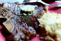 """<p>A generous pat of lemony compound butter makes these steaks an absolute must-try. You can take the same recipe and stir it into cooked pasta or rice, add it to chicken or fish recipes, or simply enjoy it on a piece of crusty French bread.</p><p><strong><a href=""""https://www.thepioneerwoman.com/food-cooking/recipes/a10736/t-bone-steaks-with-hotel-butter/"""" rel=""""nofollow noopener"""" target=""""_blank"""" data-ylk=""""slk:Get the recipe"""" class=""""link rapid-noclick-resp"""">Get the recipe</a>.</strong></p><p><a class=""""link rapid-noclick-resp"""" href=""""https://go.redirectingat.com?id=74968X1596630&url=https%3A%2F%2Fwww.walmart.com%2Fip%2FThe-Pioneer-Woman-Cowboy-Rustic-14-Piece-Forged-Cutlery-Knife-Block-Set-Turquoise%2F53967703&sref=https%3A%2F%2Fwww.thepioneerwoman.com%2Ffood-cooking%2Fmeals-menus%2Fg35191871%2Fsteak-dinner-recipes%2F"""" rel=""""nofollow noopener"""" target=""""_blank"""" data-ylk=""""slk:SHOP KNIVES"""">SHOP KNIVES</a></p>"""