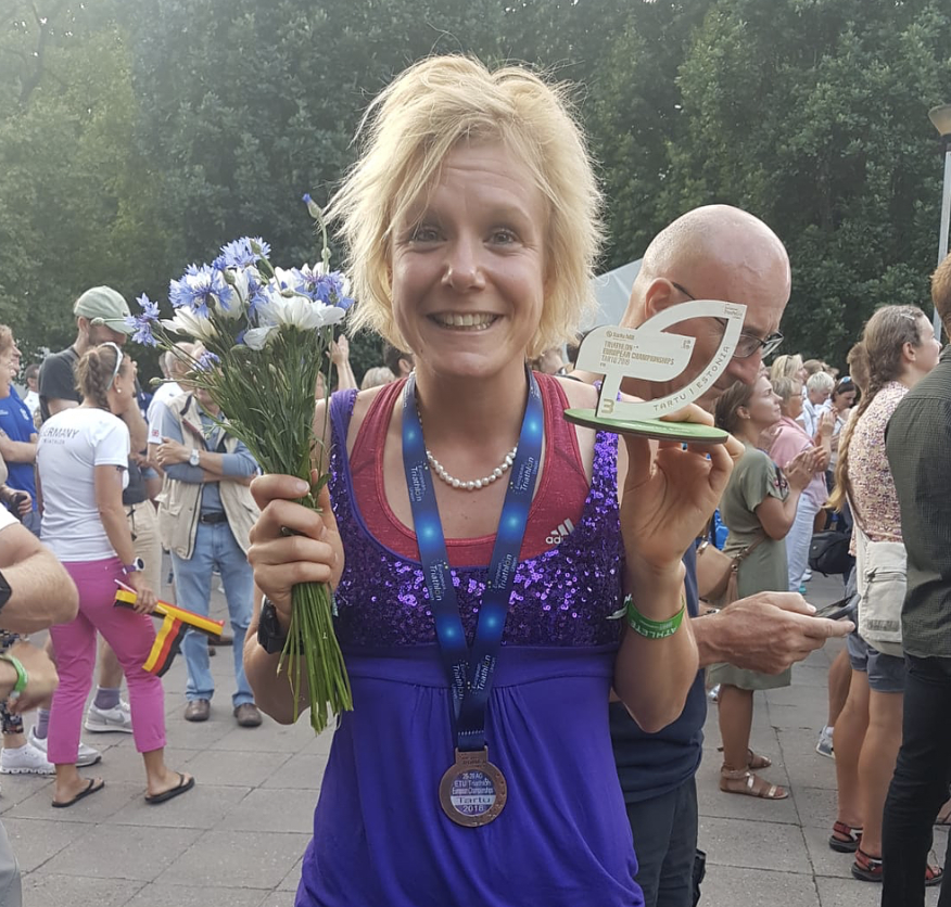 Claire Danson celebrates third place in the European triathlon age group championships and 5th place overall.