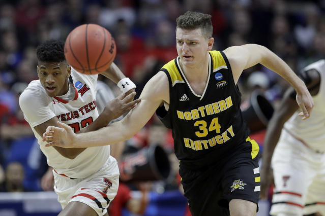 Texas Tech's Jarrett Culver (23) and Northern Kentucky's Drew McDonald (34) chase a loose ball during the first half of a first round men's college basketball game in the NCAA Tournament Friday, March 22, 2019, in Tulsa, Okla. (AP Photo/Charlie Riedel)