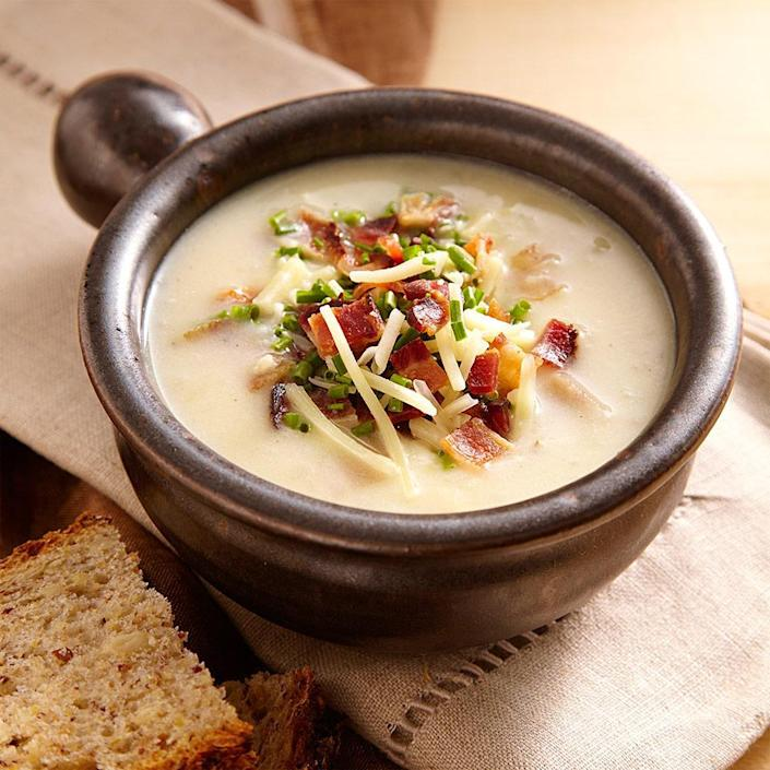 """<p>This healthy loaded baked potato soup recipe is inspired by the comforting flavor of fully loaded baked potatoes with bacon, Cheddar, sour cream and chives. To make a vegetarian version of this potato soup, omit the bacon and use """"no-chicken"""" broth. Serve it with a green salad and crusty bread to clean up the bowl.</p>"""