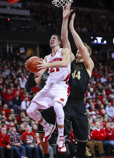 Wisconsin's Josh Gasser (21) drives against Purdue's Isaac Haas (44) during the second half of an NCAA college basketball game Wednesday, Jan. 7, 2015, in Madison, Wis. Wisconsin won 62-55. (AP Photo/Andy Manis)