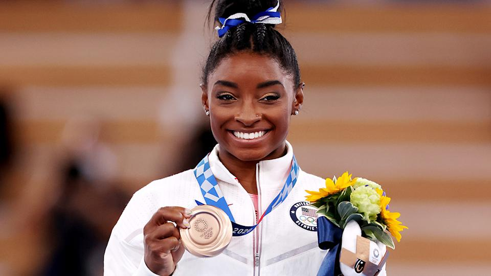 Despite withdrawing from aerial events at the Tokyo Olympics, Simone Biles earned bronze in the balance beam. (Photo by Jamie Squire/Getty Images)