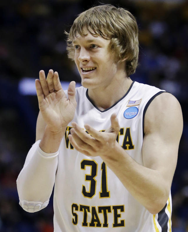 Wichita State guard Ron Baker (31) cheers against Kentucky during the first half of a third-round game of the NCAA college basketball tournament Sunday, March 23, 2014, in St. Louis. (AP Photo/Jeff Roberson)
