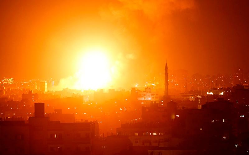 A fireball exploding during Israeli air strikes in Gaza City - AFP