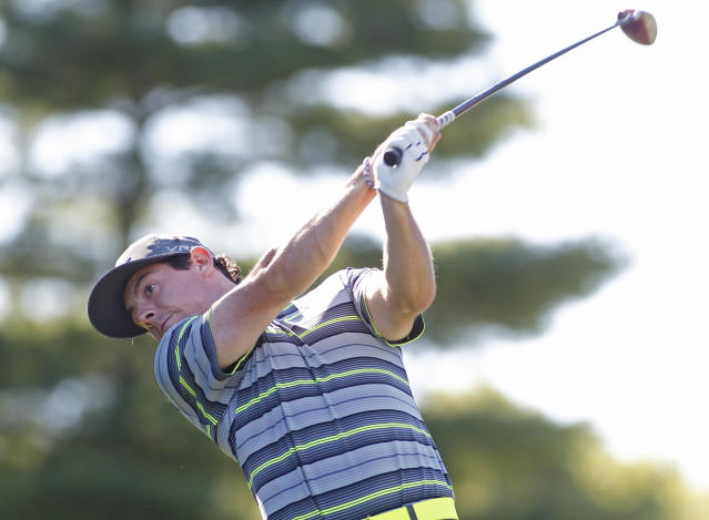 Rory McIlroy, of Northern Ireland, hits his tee shot on the tenth hole during the first round of the Deutsche Bank Championship golf tournament in Norton, Mass., Friday, Aug. 29, 2014. (AP Photo/Stew Milne)