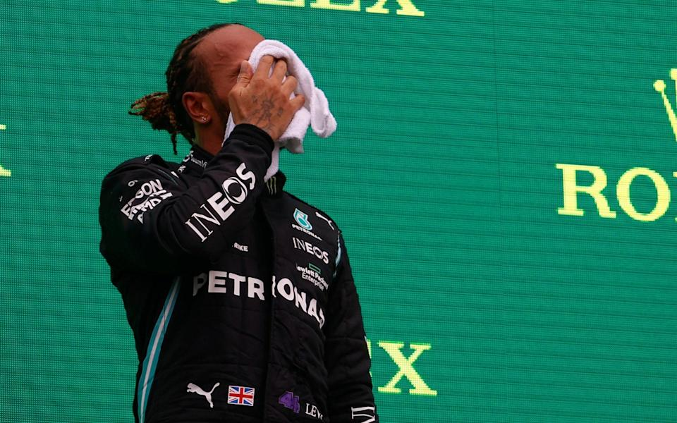 Lewis Hamilton was visibly struggling physically after the 70-lap race - REUTERS