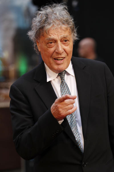 "FILE - In this Sept. 4, 2012 file photo, British playwright Tom Stoppard poses as he arrives for the world premiere of ""Anna Karenina,"" in London. The Roundabout Theatre Company said Monday, March 5, 2013, that Margulies' Pulitzer Prize-winning play ""Dinner with Friends"" will be part of its 2013-2014 theatrical season, as will a revival of Tom Stoppard's Tony Award winning play ""The Real Thing."" (AP Photo/Sang Tan, File)"