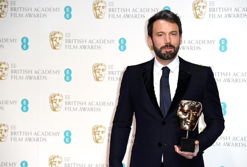 """American actor and director Ben Affleck with the award for Best Film for """"Argo,"""" at the BAFTA Film Awards at the Royal Opera House on Sunday, Feb. 10, 2013, in London. (Photo by Jonathan Short/Invision/AP)"""