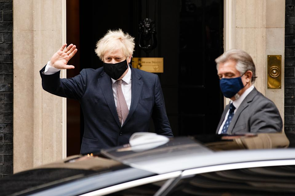 British Prime Minister Boris Johnson, Conservative Party leader and MP for Uxbridge and South Ruislip, wears a face mask leaving 10 Downing Street in London, England, on November 26, 2020. Johnson has been self-isolating for the last two weeks following notification by the National Health Service's 'track and trace' programme of contact at a Downing Street function with a fellow Conservative Party MP who later tested positive for coronavirus. The government is today meanwhile announcing which of the three 'tiers' of covid-19 restrictions will apply to local authorities across England at the end of the current national lockdown next week. (Photo by David Cliff/NurPhoto via Getty Images)
