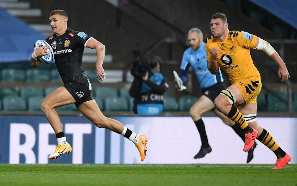 Henry Slade races away for his team's first try - GETTY IMAGES