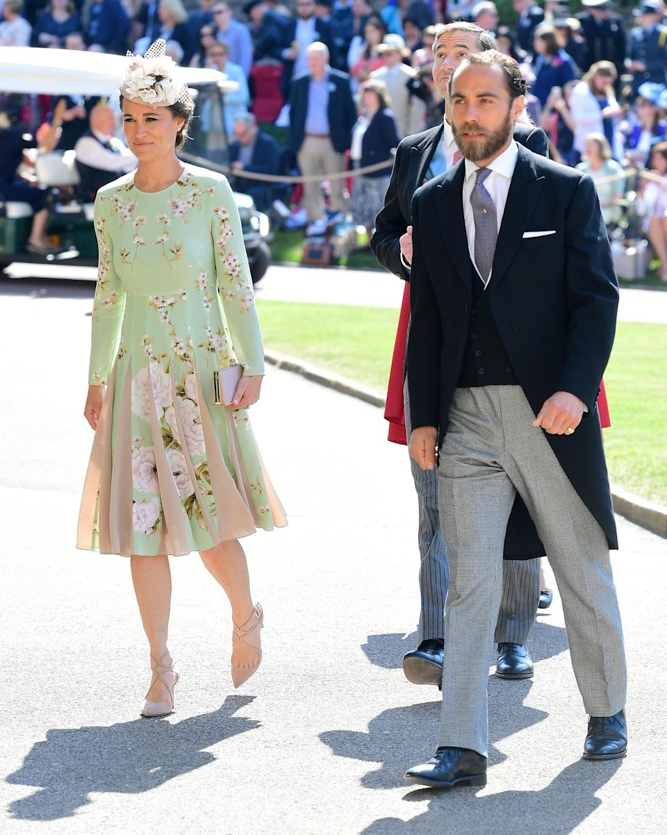 <p>The brother and sister duo arrive together. Pippa, thought to be pregnant with her first child, is wearing a dress by London brand The Fold. <em>[Photo: PA] </em> </p>